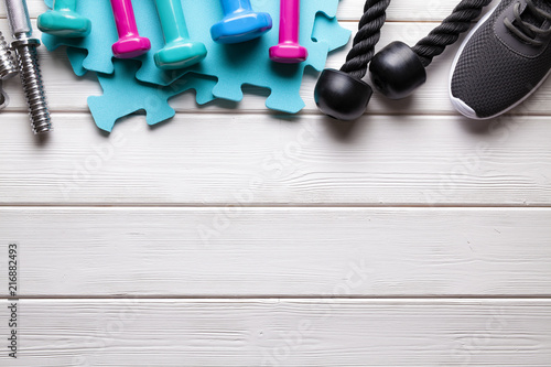 Poster Sport background - fitness equipment on wooden board