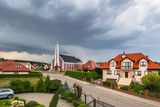 Stormy weather over the church neighborhood in Poland - 216888620