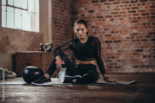 Fit woman resting after workout