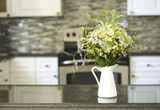 Bouquet of wildflowers in vase on kitchen table - 216892043