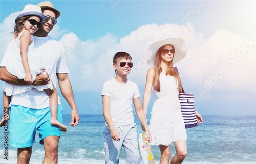 Happy family on vacations on beach - 216897079