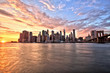 Leinwanddruck Bild - New York City Lower Manhattan with Brooklyn Bridge at Sunset