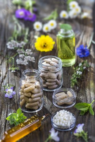 Leinwanddruck Bild alternative herbal medicine. herbal vitamin on ols wooden board background.