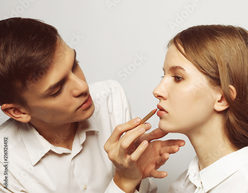 Leinwanddruck Bild make up artist doing professional make up of young woman