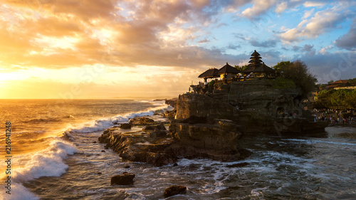 Fridge magnet Tanah Lot in sunrise colors,the most famous temple at Bali island,Indonesia
