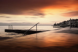 Artistic sunset view on Piran old coastal town, Slovenia. Long exposure used. - 216944458