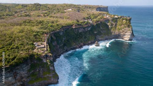 Foto Murales Aerial view at Pura Luhur Uluwatu temple. Stone cliffs, ocean waves and ocean landscape. Bali island, Indonesia.