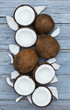 Coconuts on a rustic wooden background. - 216951651