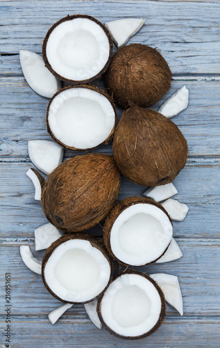 Foto Murales Coconuts on a rustic wooden background.