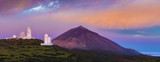 astronomical observatory against the background of a volcano at sunrise - 216954482