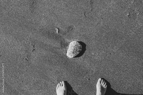 Fotobehang Bali Rock of the beach and feet