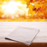 Empty wooden table with tablecloth. Napkin close up top view mock up. Autumn rustic background. - 216959068