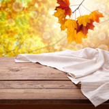 Empty wooden table with tablecloth. Napkin close up top view mock up. Autumn rustic background. - 216959210