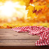 Red checkered tablecloth on wooden table. Napkin close up top view mock up. Autumn rustic background. - 216959223