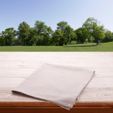Empty tableclothe on wooden desk. Summer background. Top view mock up. Selective focus. - 216959241