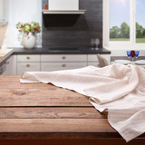 Empty wooden table with tablecloth near the window in kitchen. Napkin close up top view mock up. Kitchen rustic background. - 216959294