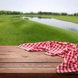 Red checkered tablecloth on wooden table with summer backround. Napkin close up top view mock up. Kitchen rustic background. - 216959417