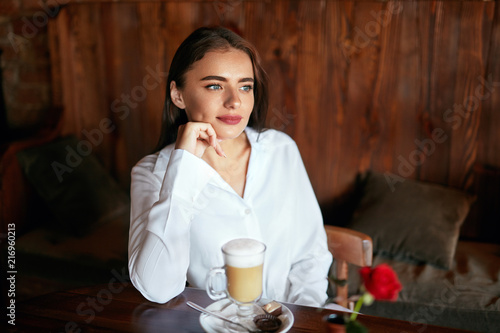 Woman Drinking Coffee In Cafe - 216960213