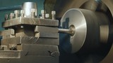 Milling machine produces metal detail on factory. Deep field of view. Heavy industry concept video. - 216969602