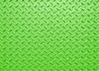 Leinwandbild Motiv green painted industrial steel sheeting with grid textured flooring pattern
