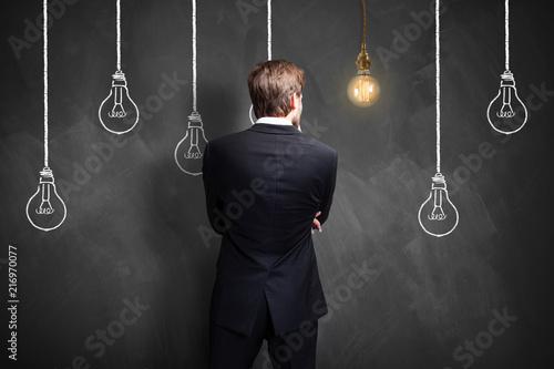 Leinwanddruck Bild Geschäftsmann mit einer Idee