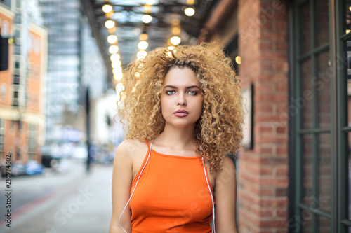 Portrait of an attractive girl walking in the street