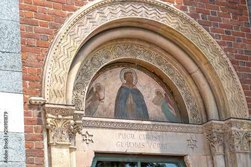 Foto Murales Basilica of Sant'Eustorgio in Milan (Italy) exterior, detail. This church was for years an important stop for pilgrims on their journey to Rome or to the Holy Land