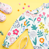 Little girl clothing and accessories - pretty dress, sandals, sunglasses. Baby summer fashion concept.