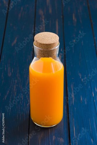 Canvas Sap orange juice on wood