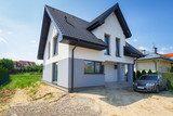 Newly built house with a finished plaster and paint - 216996827