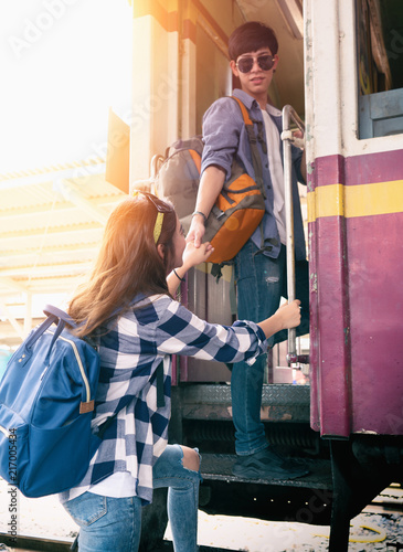 Fototapeta Young couple are travelling to up country by the train