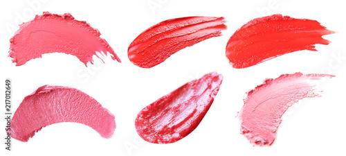 Leinwanddruck Bild Makeup product smears on white background. Color set of lip glosses and lipsticks