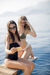Quadro Two pretty young women taking selfie on vacation at the yacht
