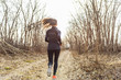 Autumn run sport athlete woman training on outdoor park. Trail runner running in fall nature forest. - 217019087