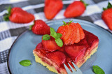 Classic traditional German Strawberry Cake on blue dish with mint leaf and fresh strawberry. - 217020451