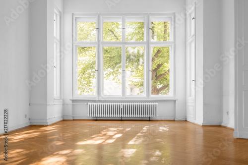 Leinwandbild Motiv window in empty room, old apartment building with  parquet floor