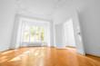 Leinwanddruck Bild - empty room in old apartment building with wooden parquet floor