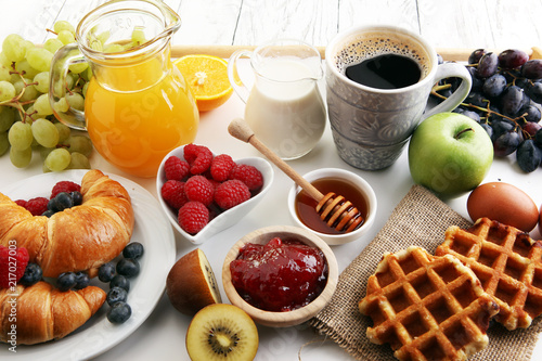Canvas Sap Breakfast served with coffee, orange juice, croissants and fruits. Balanced diet.