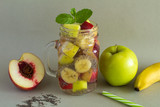 Detox water  with chia and  fruit on the grey  background