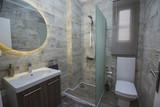 Interior design of bathroom in luxury apartment - 217032054