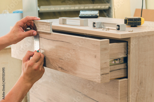 Leinwandbild Motiv Assembling of furniture closeup