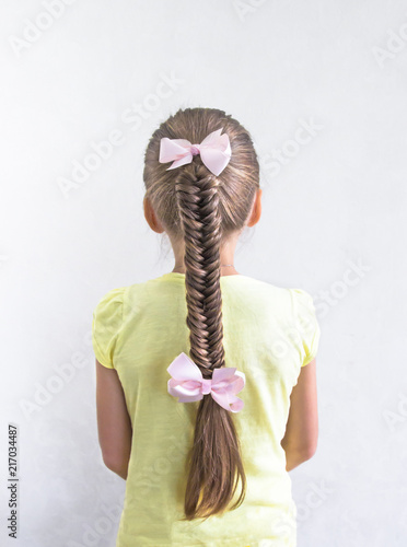 Foto Murales on white background girl with beautiful braid braid French hair weaving holiday hair ornament hair long