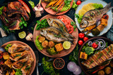 A set of food. Steak, Fish, Vegetables and Spices. On a wooden background. Top view. Copy space.