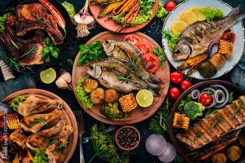 A set of food. Steak, Fish, Vegetables and Spices. On a wooden background. Top view. Copy space. - 217037266