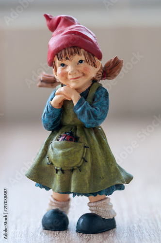 Close Up Of A Garden Gnome On A Wooden Table