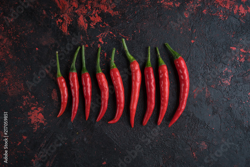 Foto Spatwand Hot chili peppers Red hot chili peppers on old wooden table with place for text