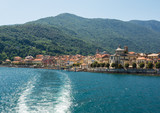 the boat starts again from Cannobio, colorful village, leaving a long trail on Lake Maggiore, Italy