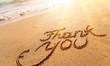 Leinwanddruck Bild - Thank you sign on sandy sea beach