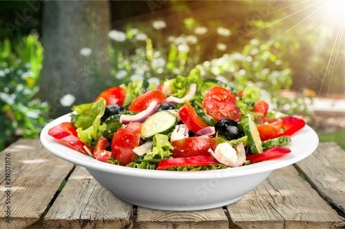 Leinwandbild Motiv Photo of fresh salad with vegetables