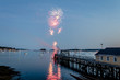 Fireworks on Boothbay Harbor, Maine, reflect off the water on July 4th for Independence Day celebration